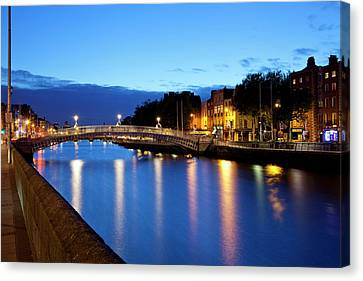 Dublin Building Colors Canvas Print - Bridge Across A River, Hapenny Bridge by Panoramic Images