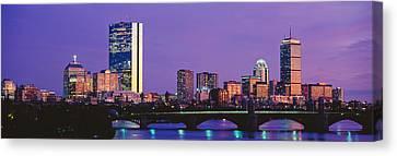 Bridge Across A River With City Canvas Print