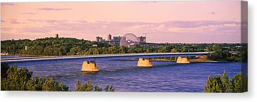 Bridge Across A River With Montreal Canvas Print
