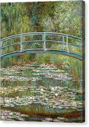 Bridge Over A Pond Of Water Lilies Canvas Print by Claude Monet