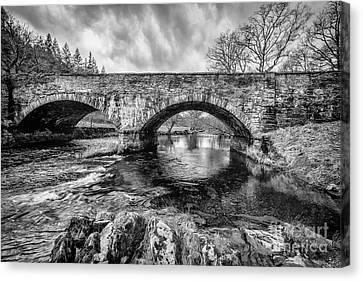 Bridge Over Llugwy Canvas Print by Adrian Evans