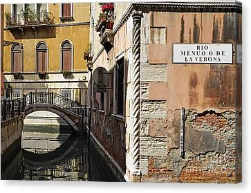 Bridge Over Narrow Canal Canvas Print by Sami Sarkis