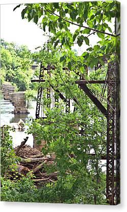 Bridge Remnants Canvas Print by Gordon Elwell