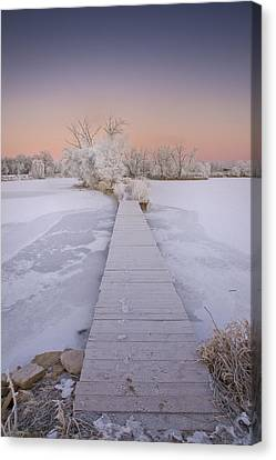 Bridging The Cold Canvas Print by Michael Van Beber