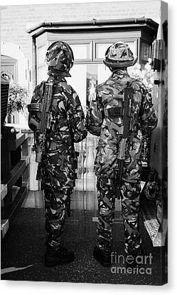 British Army Armed Soldiers In Riot Gear Watch Over House And Garden On Crumlin Road At Ardoyne Shop Canvas Print