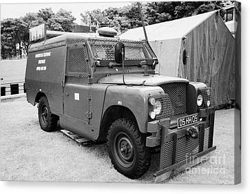 British Army Armoured Land Rover At Grey Point Fort Helens Bay County Down Northern Ireland Canvas Print by Joe Fox