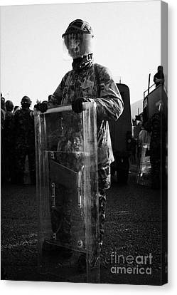 British Army Soldier In Riot Gear Stands Guard On Crumlin Road At Ardoyne Shops Belfast 12th July Canvas Print