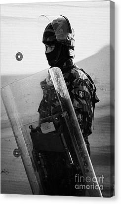 British Army Soldier With Helmet And Shield Riot Gear On Crumlin Road At Ardoyne Shops Belfast 12th  Canvas Print by Joe Fox
