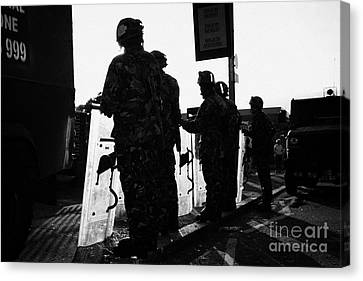 British Army Soldiers In Riot Gear With Shields Backlit Silhouette Beneath Protest Sign On Crumlin R Canvas Print