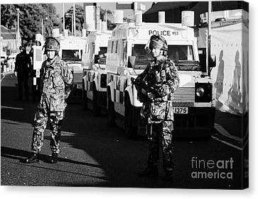 British Army Soldiers With Psni Landrovers On Crumlin Road At Ardoyne Shops Belfast 12th July Canvas Print