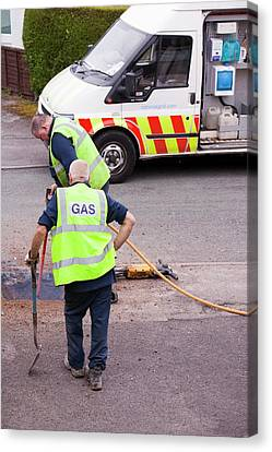 British Gas Workers Replacing Old Pipes Canvas Print by Ashley Cooper