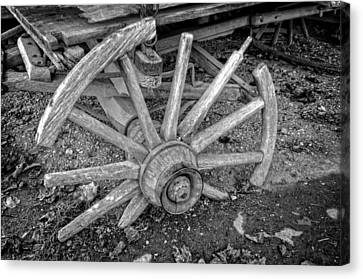 Broken Wagon Wheel In Black And White Canvas Print by Greg and Chrystal Mimbs