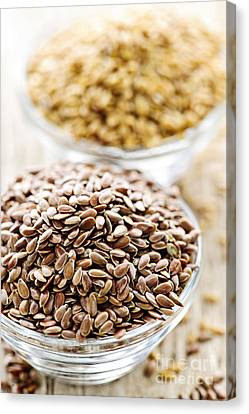 Nutrients Canvas Print - Brown And Golden Flax Seed by Elena Elisseeva