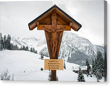 Wayside Cross Canvas Print - Brown Wayside Crucifix In The Mountains In Winter With Snow by Matthias Hauser
