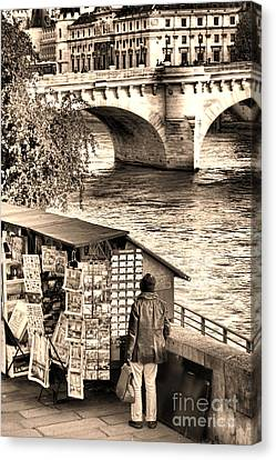 Browsing The Outdoor Bookseller  Canvas Print by Olivier Le Queinec
