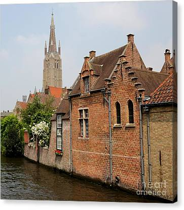 Bruges Houses With Bell Tower Canvas Print by Carol Groenen