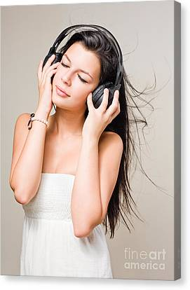 Brunette Immersed In Music Wearing Headphones. Canvas Print by Alstair Thane