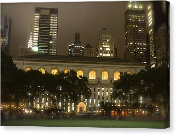 Bryant Park In New York City At Night Canvas Print by Michael Dagostino