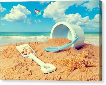 Bucket And Spade On Beach Canvas Print by Amanda Elwell