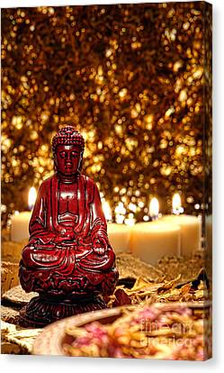 Buddha And Candles Canvas Print by Olivier Le Queinec