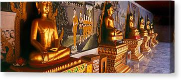 Buddha Statues In A Temple, Bangkok Canvas Print by Panoramic Images