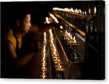 Tibetan Buddhism Canvas Print - Buddhist Monk Lighting Lamps by Nila Newsom