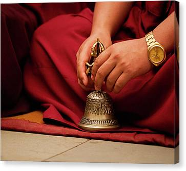 Buddhist Monk Playing Musical Bell Canvas Print by Jaina Mishra