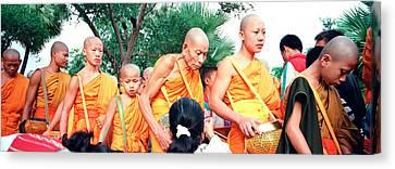 Buddhist Monks Luang Prabang Laos Canvas Print by Panoramic Images