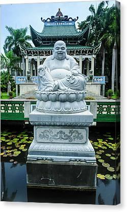 Buddhist Statue Before The Taoist Canvas Print by Michael Runkel