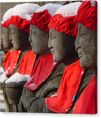 Buddhist Statues In Snow Canvas Print
