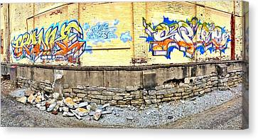 Building By The Tracks Canvas Print by Andrew Martin