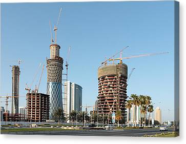 Building Doha Tower By Tower Canvas Print by Paul Cowan