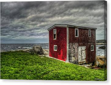 Building On The Sea's Edge Canvas Print by Ken Morris