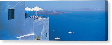Building On Water, Boats, Fira Canvas Print by Panoramic Images