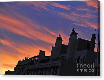 Building Silhouette By Cloudscape At Sunrise Canvas Print by Sami Sarkis