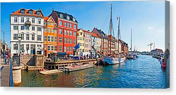 Buildings Along A Canal With Boats Canvas Print by Panoramic Images