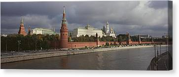 Buildings Along A River, Grand Kremlin Canvas Print by Panoramic Images