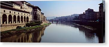 Buildings Along A River, Uffizi Museum Canvas Print by Panoramic Images