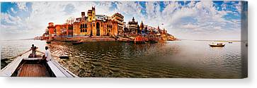 Buildings At Riverbank Viewed Canvas Print by Panoramic Images