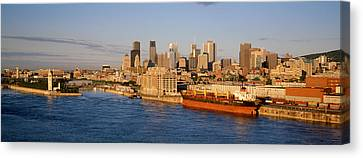 Buildings At The Waterfront, Montreal Canvas Print by Panoramic Images
