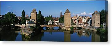 Rhin Canvas Print - Buildings At The Waterfront, River Ill by Panoramic Images