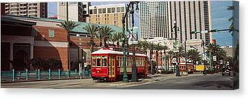 Buildings In A City, Canal Street Canvas Print by Panoramic Images