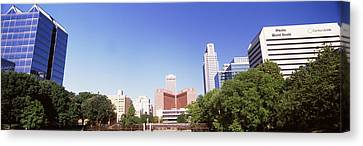 Buildings In A City, Qwest Building Canvas Print by Panoramic Images