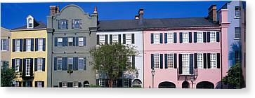 Buildings In A City, Rainbow Row Canvas Print by Panoramic Images