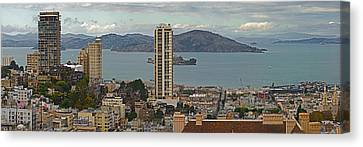 Buildings In A City With Alcatraz Canvas Print by Panoramic Images