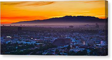 Buildings In A City With Mountain Range Canvas Print by Panoramic Images