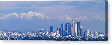 Buildings In A City With Snowcapped Canvas Print by Panoramic Images