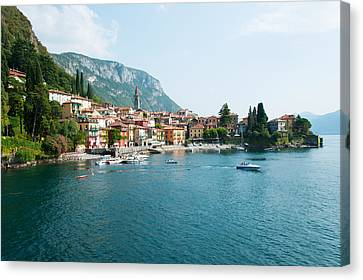 Buildings In A Town At The Waterfront Canvas Print by Panoramic Images