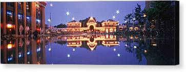 Buildings In An Amusement Park Lit Canvas Print by Panoramic Images