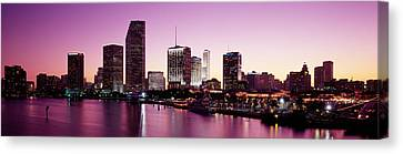 Buildings Lit Up At Dusk, Biscayne Bay Canvas Print by Panoramic Images
